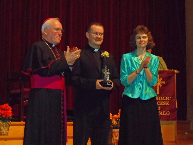 Venerable Nelson Baker award presented to Rev. Matt Nycz.